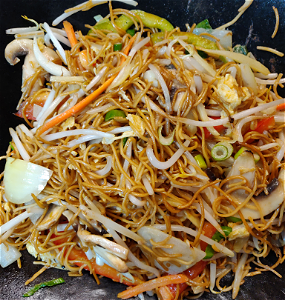 Foto Stirfried noodles vegetables