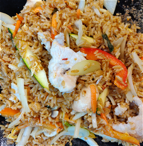 Foto Stirfried rice chicken