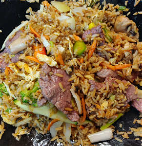 Foto Stirfried rice beef